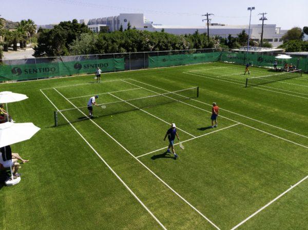 A tennis court inside Apollo Blue 5 star hotel in Rhodes awaits tennis lovers